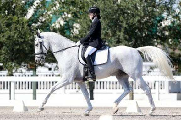 For the first time ever, three local girls qualified for the United States Dressage Federation, Region 9 team that will compete in the North American Junior and Young Rider Championships (NAJYRC) in Colorado in July.  Madeleine Ramon, 16, O'Connor senior, Kyra Shine (pictured), 16, Boerne Champion senior, and Eden Wyker, 16, Boerne High senior, will help represent Region 9 (Texas, Oklahoma, Louisiana, Arkansas, and Mississippi).  NAJYRC is the premiere international equestrian competition held in North America for riders 14-21 years of age from the United Staets, Canada and Mexico.
