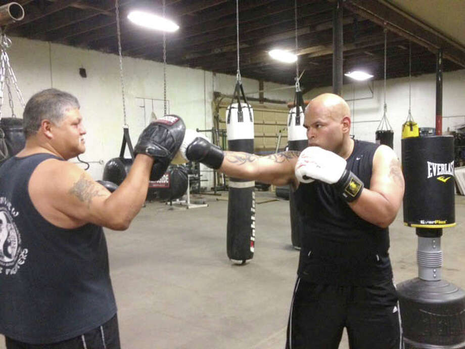 "Plainview Police Officer Sergio Trevino (right) trains with Tommy Alcozar in preparation of the ""Battle of the Badges"" Saturday in Amarillo. Photo: Courtesy Photo"