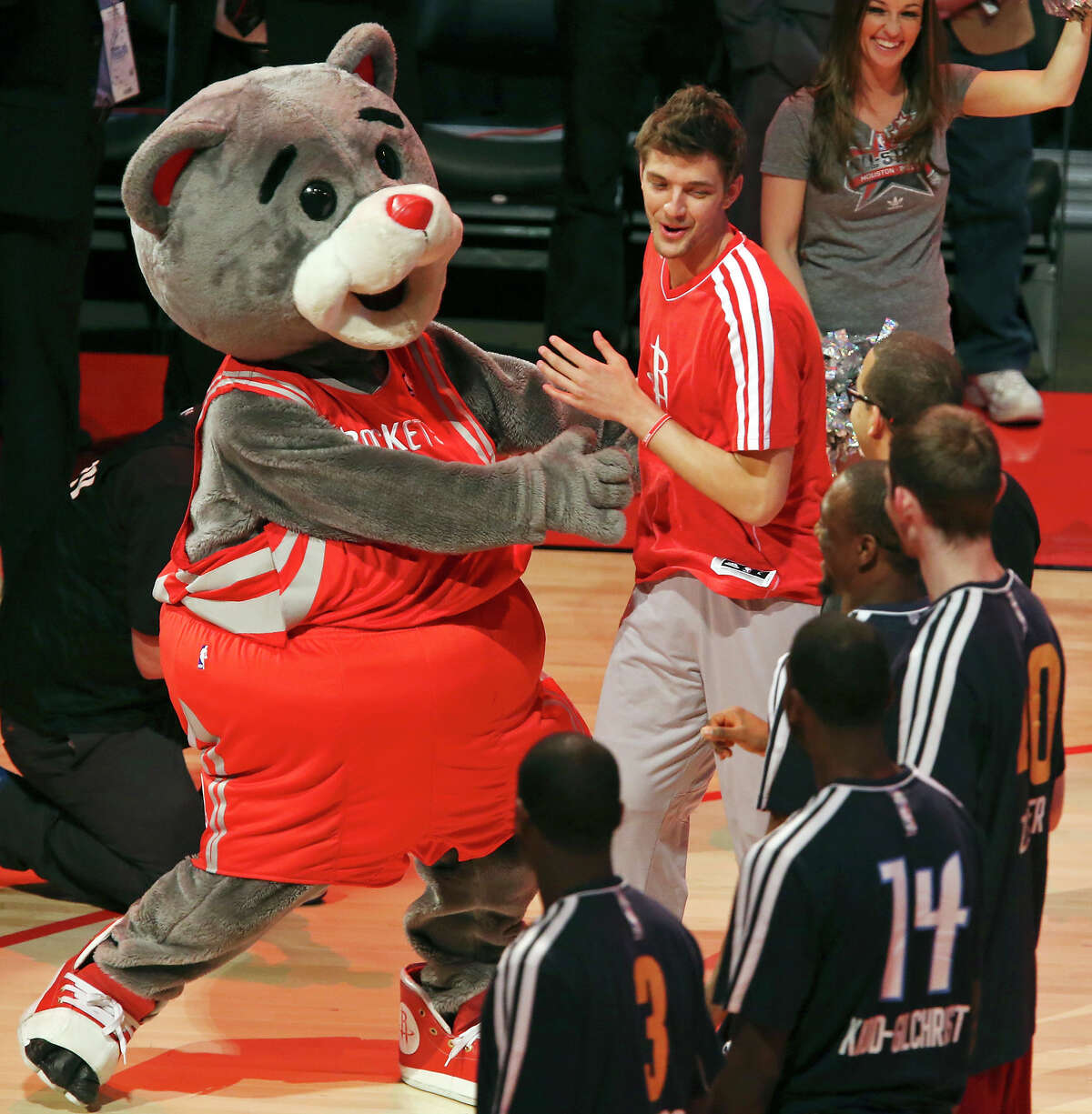 Houston Rockets mascot Clutch greets Team Shaq's Chandler Parsons before the BBVA Rising Stars Challenge at the Toyota Center Friday Feb. 15, 2013 in Houston, Tx.