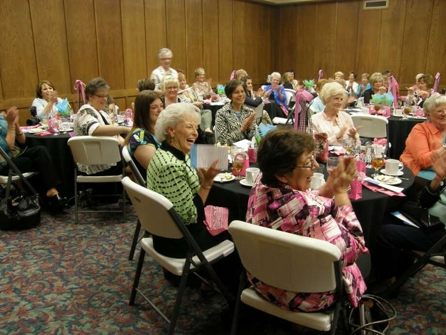 Deborah Zacher/Wayland Baptist UniversityLinda Adkins (front left), granddaughter of Dr. James and Sarah Wayland, laughs during the live auction at the Power of the Purse luncheon honoring the Sally Society. Adkins is joined at her table by Alex Hall (left, clockwise), Nancy Stukey, Pat Walter and guest speaker Sue Ann Bonner. Photo: Picasa