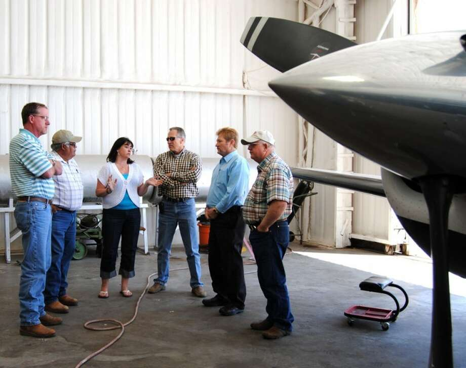 Plainview-Hale County Airport manager Stacie Hardage describes operations inside the maintenance hangar Friday to members of the Hale County Commissioners Court, including Harold King (left), Mario Martinez, Kenny Kernell, Judge Bill Coleman and Benny Cantwell. The officials toured the airport to view recent improvements during their regular Friday work session. Photo: Doug McDonough/Plainview Herald