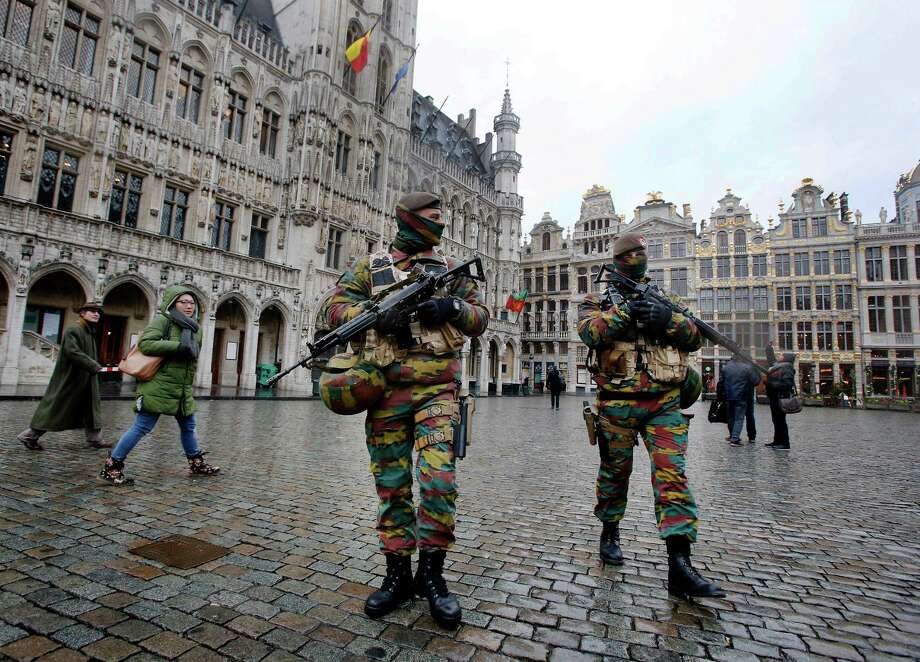 Officers patrol the Grand Place in Brussels in 2015. Fears of terrorism can prompt travelers to cancel trips. Photo: Michael Probst, STF / Copyright 2016 The Associated Press. All rights reserved. This material may not be published, broadcast, rewritten or redistribu