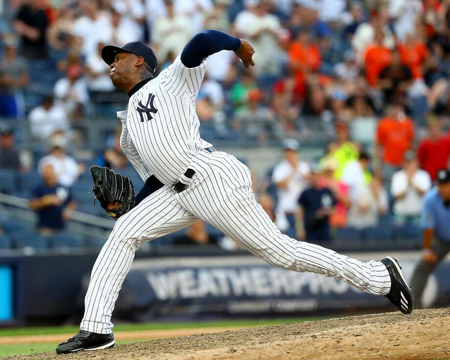 NEW YORK, NY - JULY 23:  Aroldis Chapman #54 of the New York Yankees delivers a pitch in the ninth inning against the San Francisco Giants on July 23, 2016 at Yankee Stadium in the Bronx borough of New York City.  (Photo by Elsa/Getty Images) Photo: Elsa, Getty Images