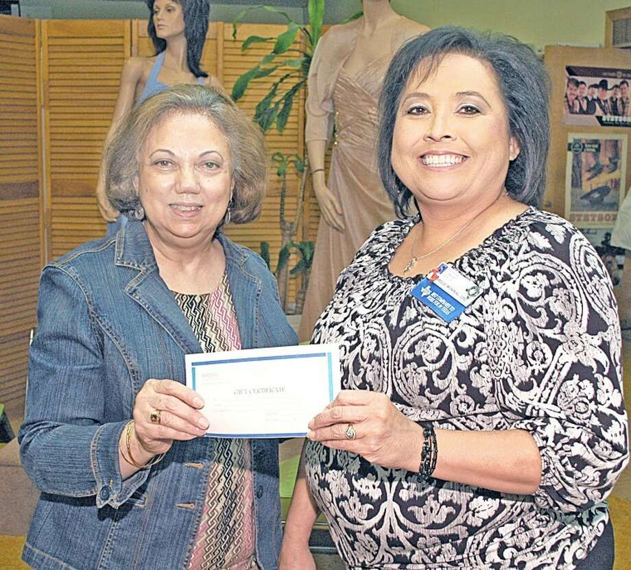 Maybelle Monreal (right) was the winner in the 2012 Celebrations promotion drawing. Handing her the certificate is Georgette Masso of Masso's Department Store, where Monreal registered for the contest while shopping in the formal wear department. She received gift certificates from all of the retail stores participating in the Herald's spring promotion.