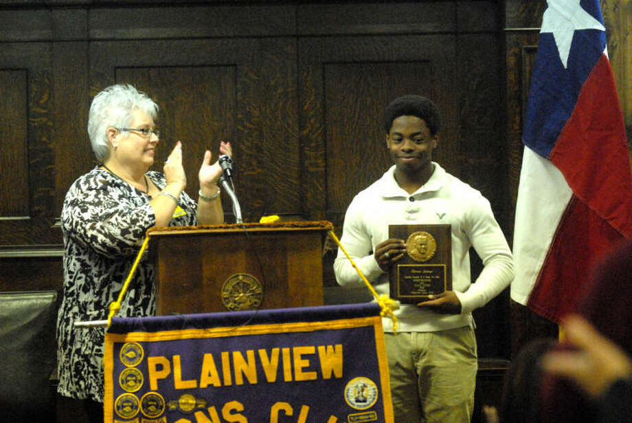 Lion's Club representative Linda Morris presents PHS senior Shirmar Jennings with the 63rd Annual LaVern Roach Award during Wednesday's club meeting. Photo: Homer Marquez/Plainview Herald