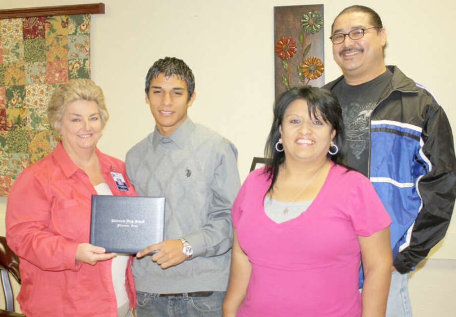 Jan Seago/Plainview ISDHouston School Principal Dana Broyles (left) congratulates Antonio Espinoza on his completion of the requirements for graduation. His parents, Roland and Norica Rodriguez, are also pictured. Espinoza and other Houston High School students who completed graduation requirements this year will participate in graduation ceremonies with Plainview High School students in May.