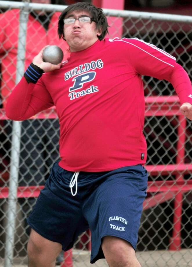 Guillermo Leal prepares to heave the shot put at the Reagor-Dykes Bulldog Relays. Photo: Kevin Lewis/Plainview Herald