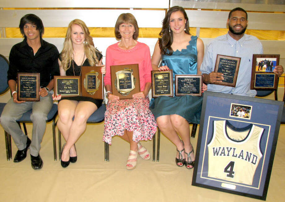 Photos courtesy of Wayland Baptist University(Left) Wayland Baptist Athletics Director Dr. Greg Feris presents freshman Laura Castillo with the Flying Queens Newcomer of the Year Award at Sunday evening's Spring Athletic Awards Banquet held at the Laney Center. Castillo is a former Plainview High School all-stater. Taking home major awards at Wayland Baptist's 2013 Spring Athletic Awards Banquet were (above) Wallace & Janis Davis Award of the Spirit winners Lucius Lopez (left) and Eric Milam (right), Roscoe Snyder Outstanding Senior Athlete Kyli Smith (second from left), Roy McClung Service Award winner Rhane Jeffress (center) and Bill Hardage Champions of Character Award winner Aubrey Pedigo (fourth from left).