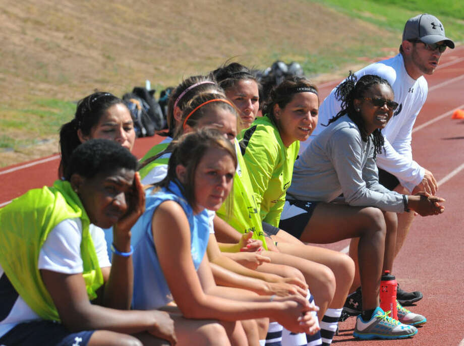 Members of the Wayland Baptist University women's soccer team watch a game from the bench last season. The squad has a rugged non-conference schedule lined up for the coming season. Photo: Kevin Lewis/Wayland Baptist University