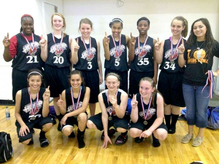 Hoop 55, a team of 14-year-old girls from Plainview and Lubbock, won the championship at the Mid America Youth Basketball Tournament in Lubbock on April 1. Members are (back, from left) Toniqua Bell, Emily Stevens, Jaci Wirth, Brittany Rincon, Khrya Riddley, Lauren Swanson, Coach Ashley De La Cruz; (front) Caitlyn Isaguirre, Amanda Sepeda, Courtney Archer and Katie McCloud. Not pictured are Karley Thrasher and Coach David Jackson. Hoop 55 features more than a dozen teams of varying ages and is coordinated by former Plainview Lady Bulldog and Texas Tech Lady Raider Alesha Robertson, now head coach for the Lubbock Christian High School Lady Eagles.