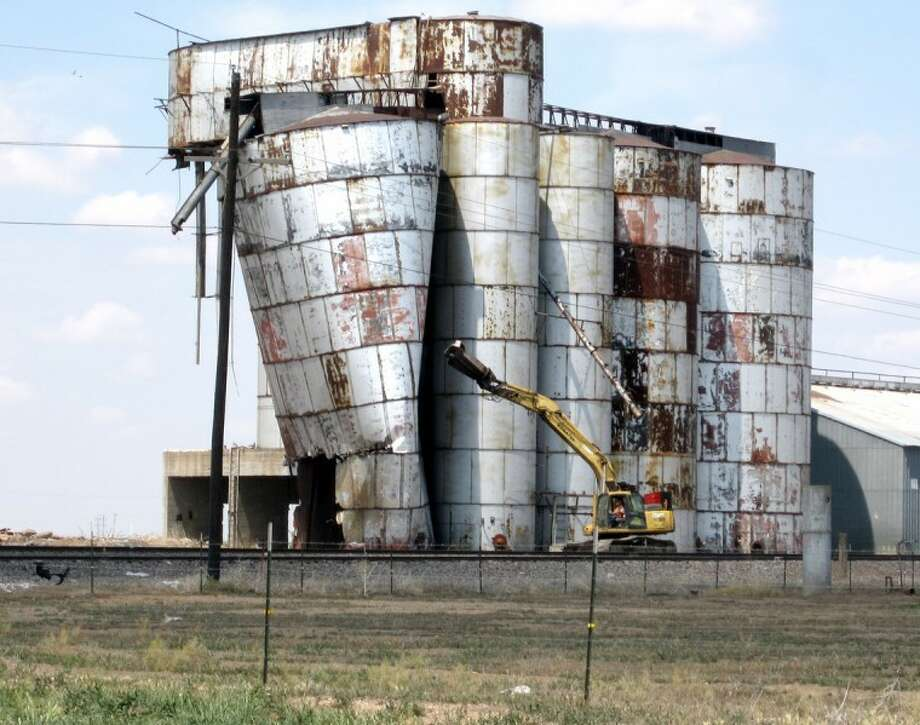 Courtesy Photo by David HughesCrews this week are demolishing rusty old grain elevator tanks at the intersection of Business I-27 and Farm-to-Market Road 145 in Kress.