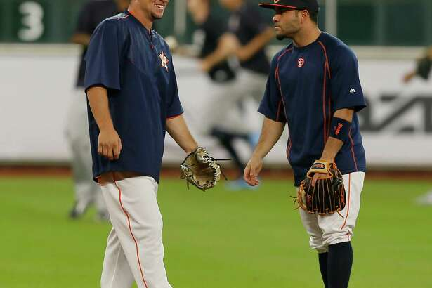HOUSTON, TX - JULY 25:  Alex Bregman #2 of the Houston Astros, left, talks with Jose Altuve #27 during batting practice before his MLB debut against the New York Yankees at Minute Maid Park on July 25, 2016 in Houston, Texas.