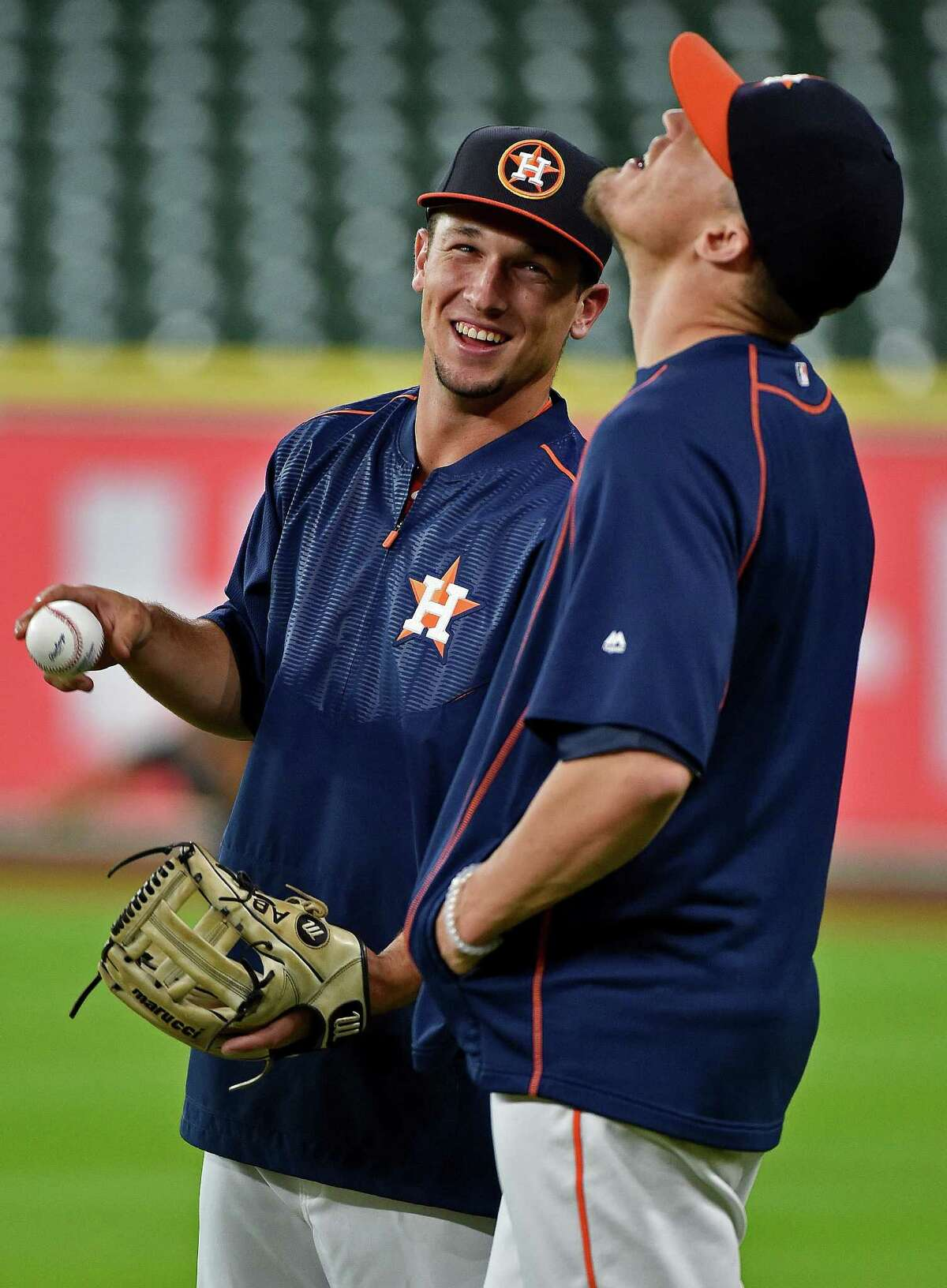 Houston Astros third baseman Alex Bregman, left, shares a laugh with relief pitcher Ken Giles before a baseball game, Monday, July 25, 2016, in Houston. (AP Photo/Eric Christian Smith)