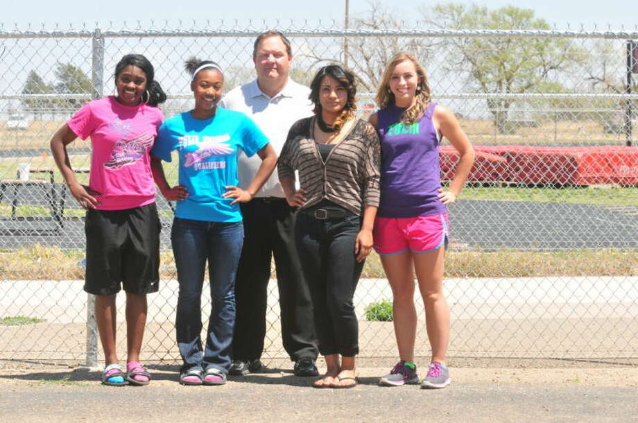 The Tulia sprint relay team is made up of (from left) Mariah Powell, Markeyla Hicks, Saragosa Rodriguez and Ashley Young. Standing behind the quartet is Coach Jerry Walker. The Lady Hornets are looking to finish in the top three at the UIL State Track and Field Championships in Austin Saturday. In addition, Hicks will compete in the 200-meter dash.  Photo: Skip Leon/Plainview Herald