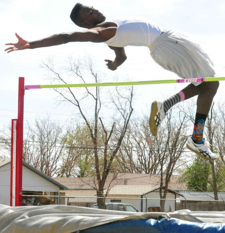 Dearius Poindexter clears the high jump bar with plenty of room to spare during practice Tuesday afternoon. The Hale Center senior will be seeking Class 1A Division 1 state championships in the high jump, long jump and triple jump at the UIL State Track & Field Championships in Austin Friday and Saturday.  Photo:      Skip Leon/Plainview Herald