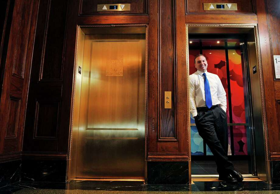 Wesley Horth, director of business development for Bay State Elevator, stands by the elevators inside at the Rennaisance Hotel on Tuesday, July 19, 2016, in Albany, N.Y.  The company installed the elevators inside the hotel during the recent renovation of the building.  (Paul Buckowski / Times Union) Photo: PAUL BUCKOWSKI / 20037365A