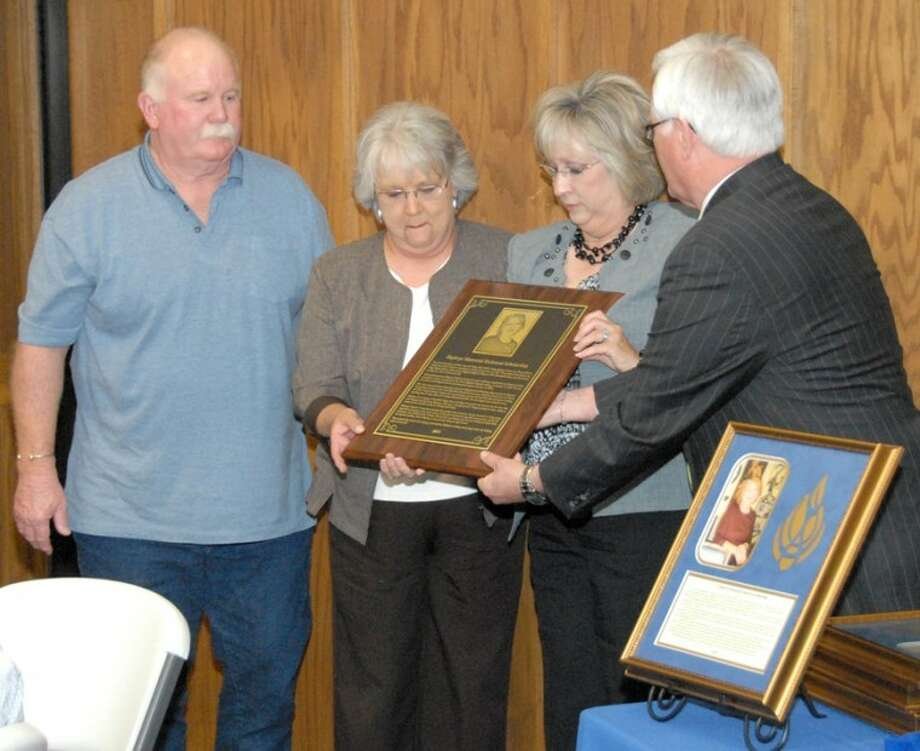 Jonathan Petty/Wayland Baptist UniversityDanny Andrews (right) director of alumni development, presents the endowed scholarship plaque to the family of Zaphryn Green, including her husband Jim Green (from left) and sisters Marilyn Webb and Teresa Taylor.