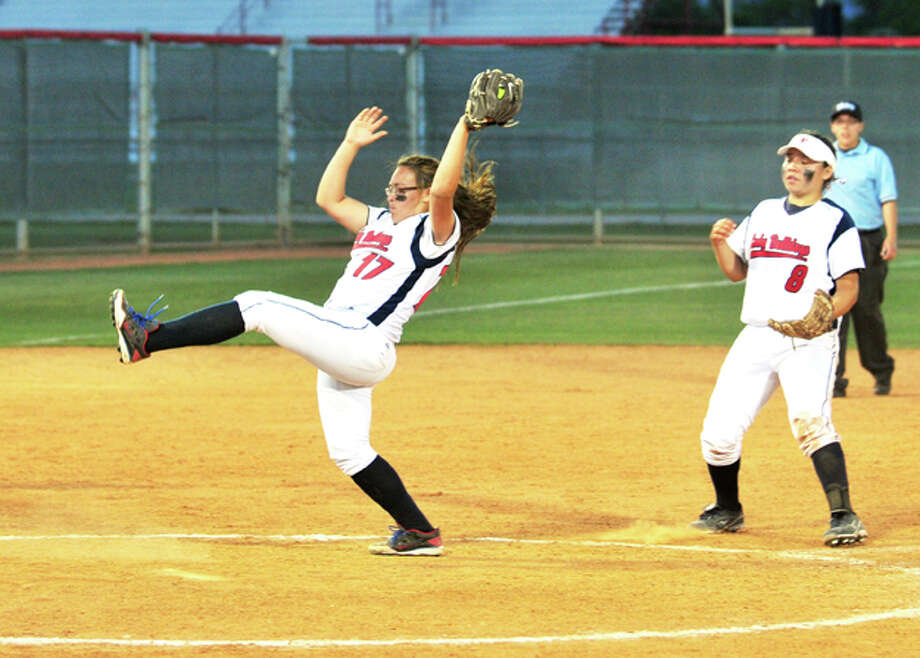 As shortstop Aubrey Enriquez backs her up, PHS reliever Monica Perez stretches to snag a pop fly hit back to the mound for the third out in the sixth inning in the Lady Dogs' loss to Dumas on Friday at Lady Bulldog Park. Photo: Summer Morgan/Plainview Herald