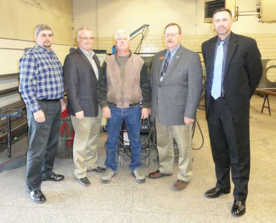Plainview Entrepreneurial Guide Alliance's Eric Turner (left) and Paul Henderson with South Plains College are pictured with Jeff Novotny of Larson International, Plainview ISD Superintendent Dr. Ron Miller and PHS Principal Tye Rogers. PEGA, SPC and PISD have teamed up on a program to train welders. Photo: Carmen Ortega/Plainview Herald