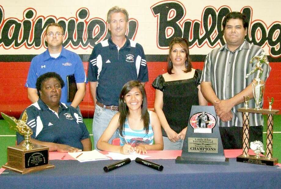 PHS distance runner Daisy Guerrero signs a letter of intent to run cross country and track at Wayland. She's surrounded by PHS girls track coach Della Riggins (clockwise), WBU cross country coach Brian Whitlock, PHS cross country coach Randy Stutes and parents Maria and Johnny Guerrero. Photo: Summer Morgan/Plainview Herald