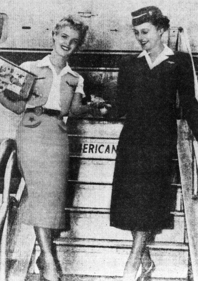 Jerry Seigler, left, hands a horned toad to an American Air Lines stewardess as part of a publicity stunt in 1952 when she was a stewardess for Trans Texas Air Lines. Later, she worried that she might be fired for not wearing her hat. Photo: Courtesy Photo