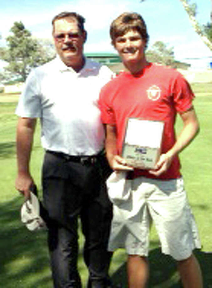 PHS golfer Thomas Wirth (right), shown here with coach Mike Lewis, recently was named FOX 34 News State Farm Athlete of the Week. Wirth held the individual lead during the first two rounds of district play, turning in a 78 and a 71. After shooting a third-round 76, he finished in second place. Photo: Courtesy Photo