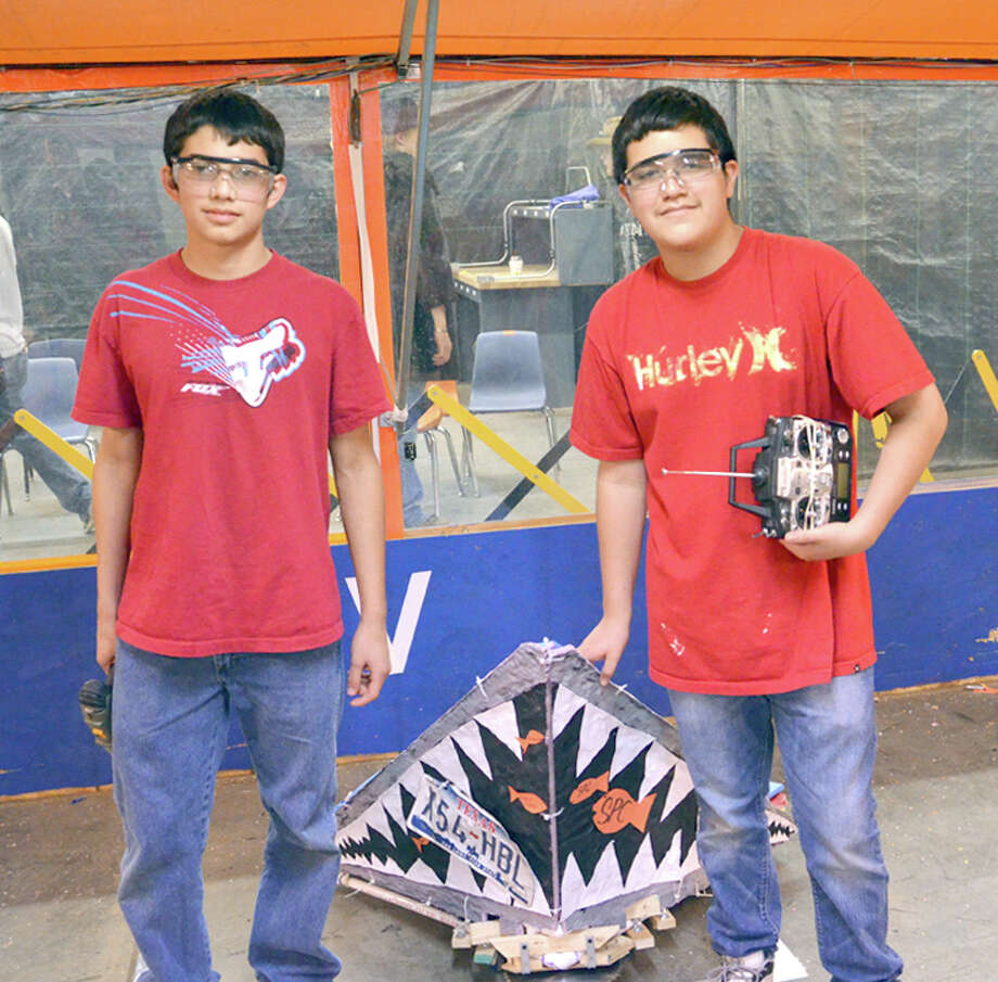 The robotics teams from Plainview High School claimed the Tin Man X competition recently at South Plains College Reese Center campus. The Jaws Team is comprised of R.A. Nava, Derek Adame and Angel Ybarra. Teams from Plainview High School swept all three rounds of the competition. Photo: West Underwood/South Plains College