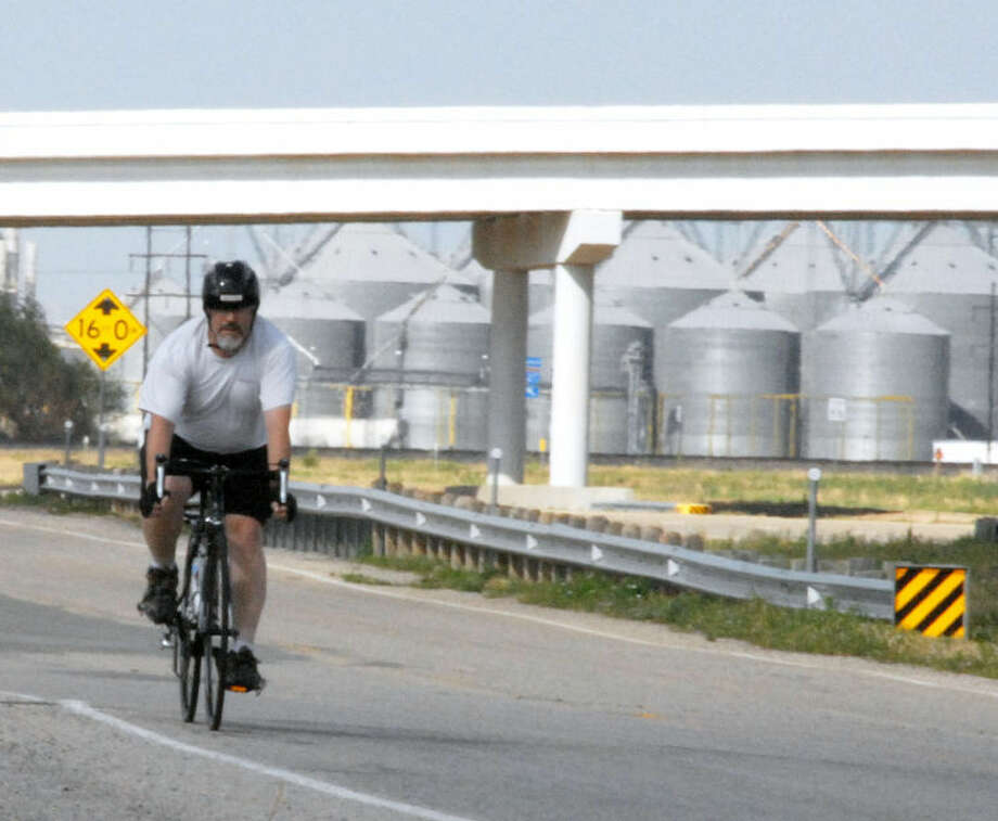 Wayland's Assistant Director of Communications Richard Porter cycles down I-27 as he trains for his three-day 333-mile bike ride to raise money to create an endowed scholarship for missionary majors at the university. Photo: Courtesy Photo