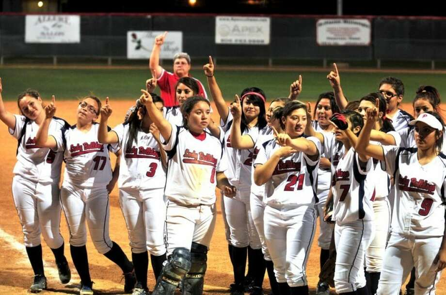 Members of the Plainview Lady Bulldog softball team salute the stands as they sing the school song following a recent game at Lady Bulldog Park. The Lady Dogs will be in Wolfforth today for a 6:30 p.m. game against Frenship. Plainview likely needs to win the regular-season finale to force an extra game with Dumas for the District 3-4A No. 3 playoff seed. If Plainview loses, the Lady Dogs likely will be the No. 4 seed. Also today, the Bulldog baseball team battles for its playoff lives when it hosts Palo Duro at 5 p.m. today at Bulldog Park while the Wayland Pioneers host Lubbock Christian in a single game at Wilder Field, also at 5 p.m.