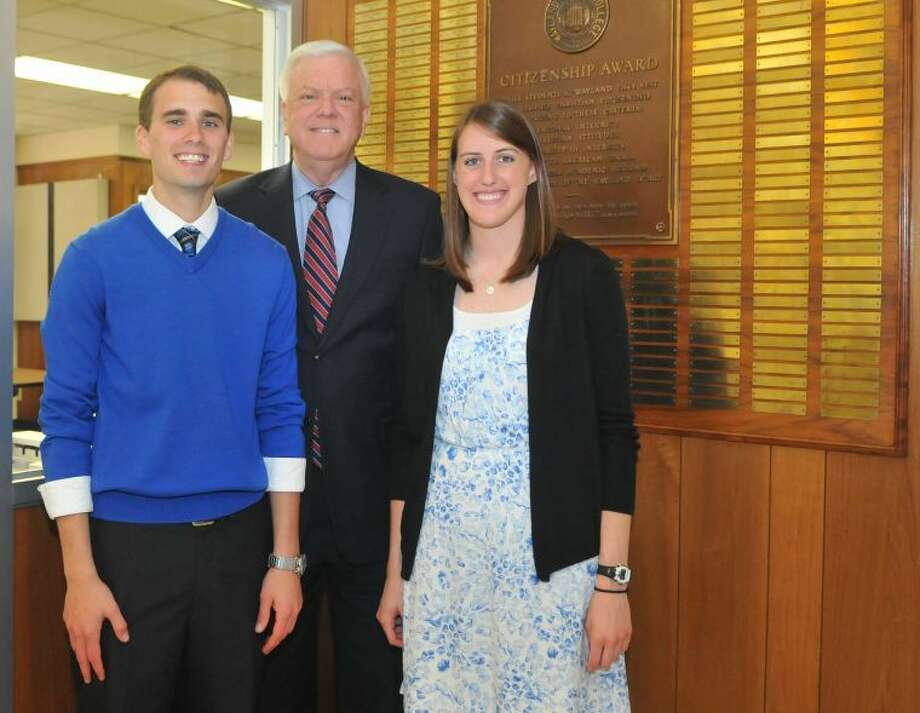 Wayland Baptist University seniors Kennan Harris of Perryton and Libby Saultz of Amarillo stand with Wayland President Dr. Paul Armes in front of the Citizenship Award plaque in Gates Hall. Harris and Saultz affixed their names to the plaque as the 57th man and woman to receive the Citizenship Award, the highest recognition given to Wayland students. The award was announced Wednesday during the annual Recognition Chapel. Photo: Jonathan Petty/Wayland Baptist University