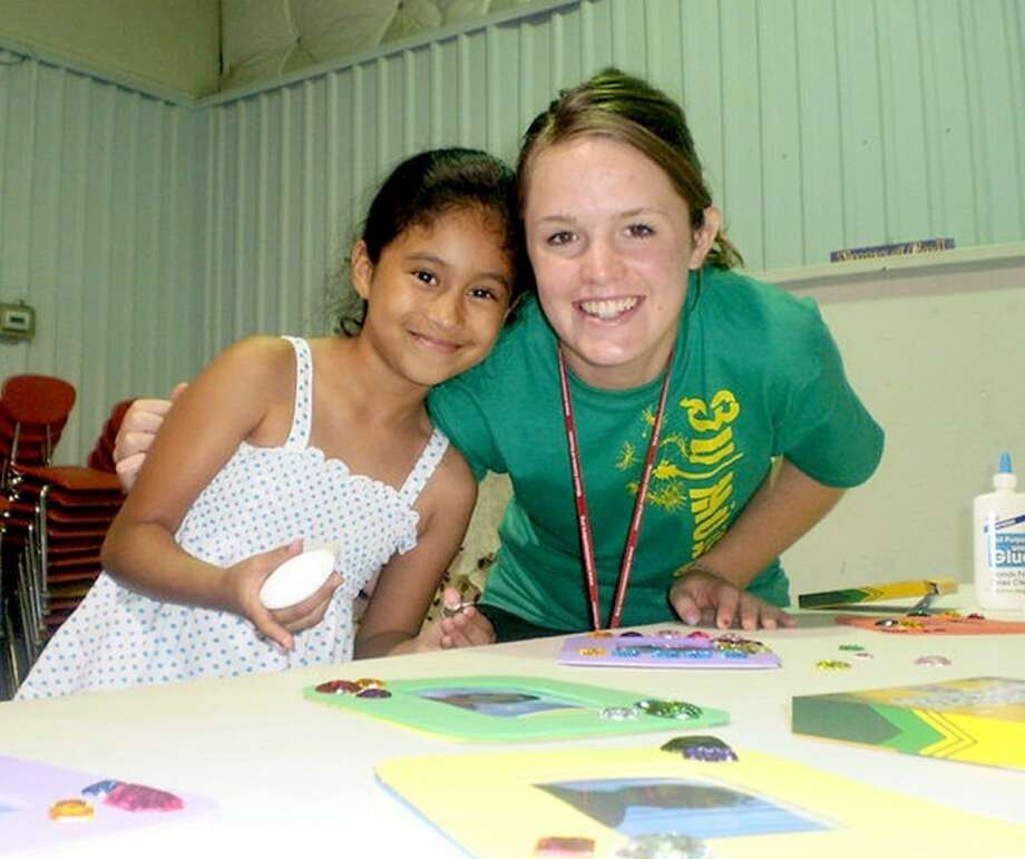 Courtesy PhotoWhitney Moore works with a child as part of her Go Now Missions assignment in Houston in summer 2010. Moore, a 2009 graduate of Anton High School, is studying social work at West Texas A&M University and has participated in three short-term missions through Go Now. The organization is one of many that will be participate in Saturday's Experience Mission 2012 conference at Wayland.