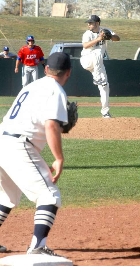 Wayland pitcher Robert Carson of Puerto Rico winds to throw home as first baseman Brian Allen holds a runner during Tuesday's game against Lubbock Christian at Wilder Field. Wayland (13-34) plays its final home games of the season against Southern Nazarene with a doubleheader at 4 p.m. today then a single game at 1 p.m. Friday. The Plainview Bulldogs (8-18), still in the mix for a playoff spot, play at 5 p.m. Friday in Hereford then host Dumas at 1 p.m. Saturday.