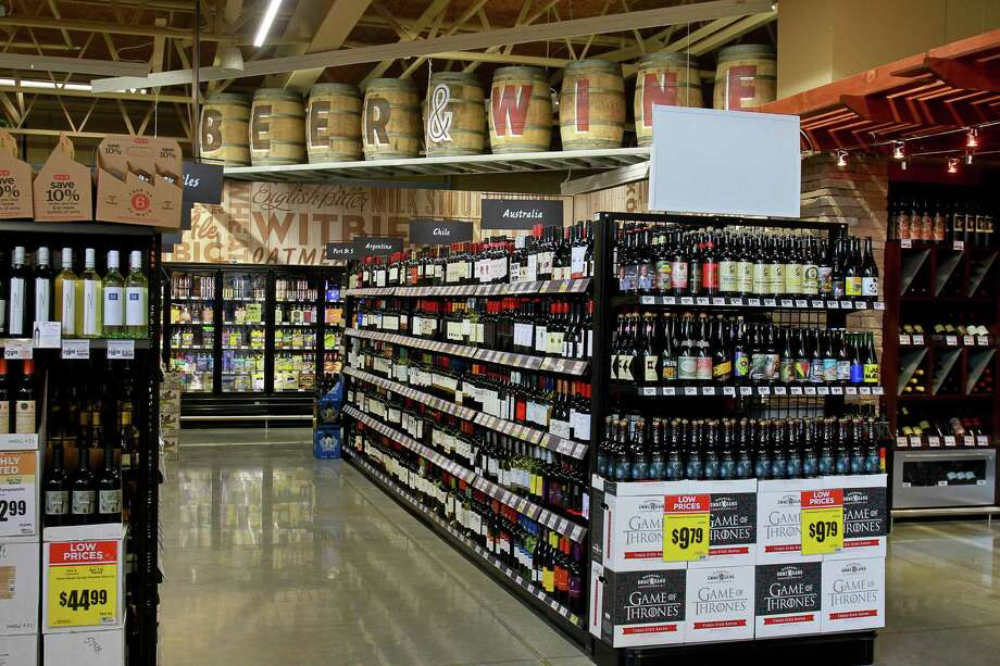 A beer and wine department is shown at the H-E-B at 5895 San Felipe. H-E-B hopes to offer such sales in a dry part of the Heights. Photo: Gary Fountain, Freelance / Copyright 2015 by Gary Fountain