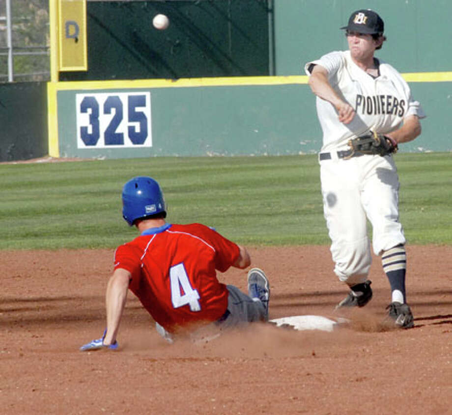 Wayland second baseman Calvin Bass, after forcing out LCU's Brent Leslie (4), throws to first in an attempt to complete a double play during Tuesday's game at Wilder Field. Photo: Kevin Lewis/Plainview Herald