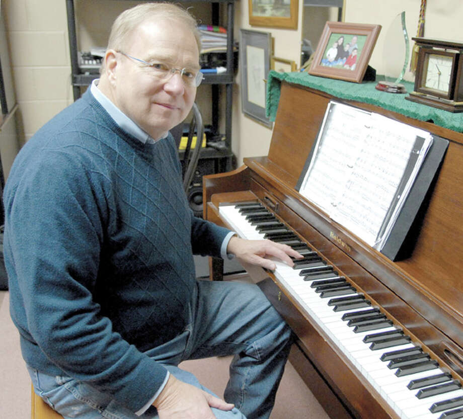 Robert Black, associate professor of church music at Wayland, sits at the piano in his office. Black, who had a long career as a leader of worship, will retire after spending the last 12 years in the classroom.