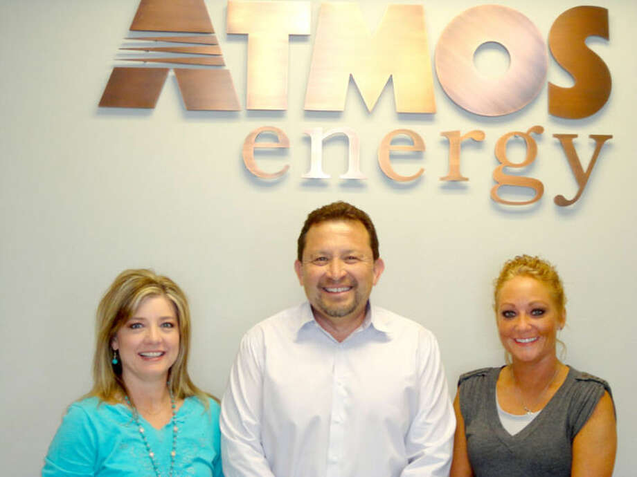Jamie Leatherwood/Plainview HeraldAtmos Energy at 200 S. 1-27 will host the next Business After Hours mixer from 5-6:30 p.m. Thursday at its new service center. Promoting the informal business mixer are V.O. Ortega, local Atmos operations manager, flanked by Kim Street (left) and Lacy Todd, Business After Hours co-chairs for the Plainview Chamber of Commerce. Refreshments and door prizes will be available, and members of the business community are encouraged to attend.