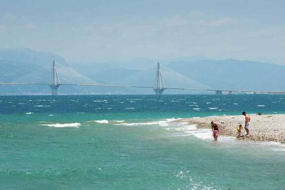 The new Rio-Antirrio bridge, which connects northern Peloponnese back to the mainland, as seen from a beach in Patras, Greece.
