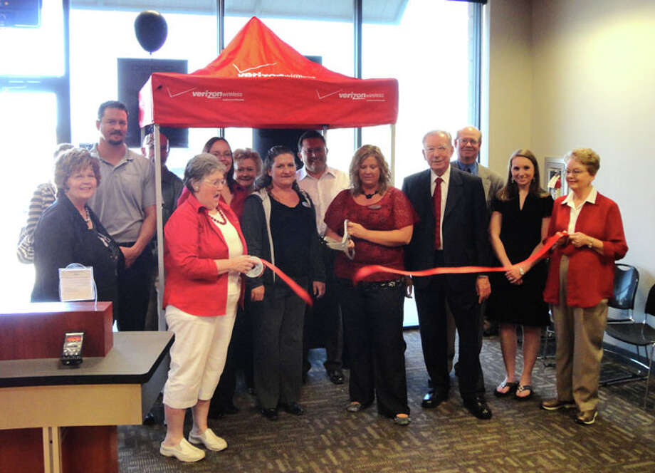 Brian McGann/Plainview HeraldA ribbon cutting hosted by the Plainview Chamber of Commerce recently was held at Russell Cellular. Representing the Verizon dealer in the strip center north of Walmart Supercenter are (from left) Phyllis Marshall, Joseph Gant, Dixie Collin, Michelle Baldonado and Mary Pineda. Chamber representatives include Kenneth Hooper (behind pole), Janice Payne (holding ribbon), Alice Sawayer, V.O. Ortega, Mayor John C. Anderson, Mike Fox, Emilee Leftwich and Mary Anna Self.