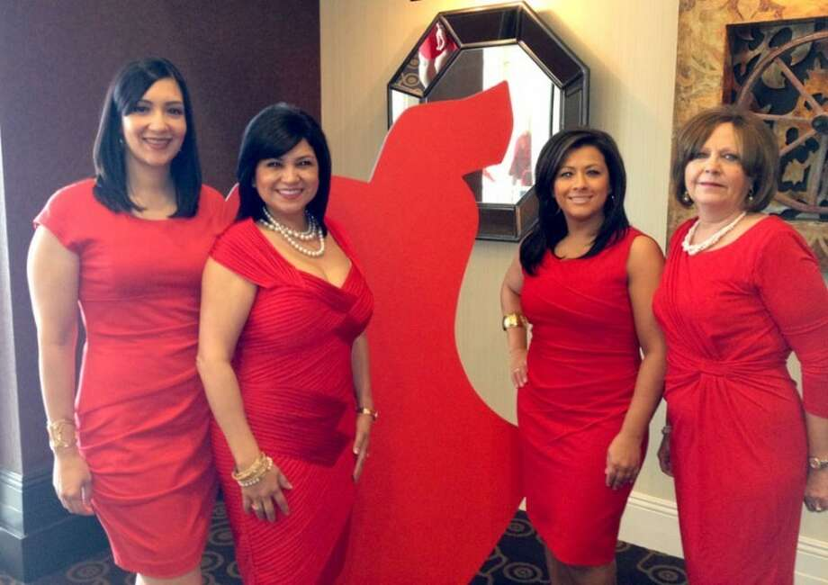 "Courtesy PhotoClaudia Lara (left), wife of Dr. Sergio Lara; Nancy Kernell, a member of the Circle of Red Society; Veronica Rodriguez, owner of Veronica's Spa and Hair Salon; and Debbie King, wife of Covenant Hospital Plainview CEO Alan King, attended the Go Red For Women luncheon at the Overton Hotel and Conference Center in Lubbock on Thursday. The Circle of Red is a ""dynamic, committed and passionate group of women who have the resources to significantly impact the community by providing a personal commitment to help find a cure for heart disease, the No. 1 killer of women."" Women throughout the country are contributing resources and influence to fight women's heart disease and raise awareness for the cause."