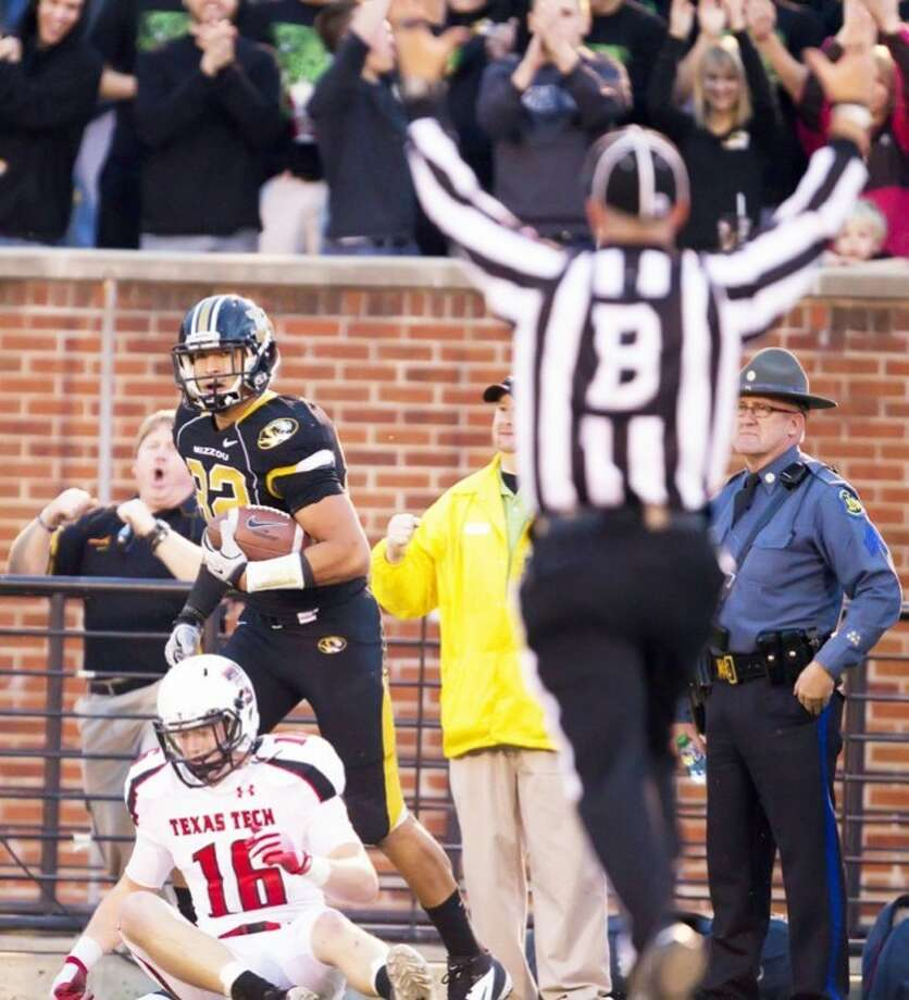 Missouri tight end Michael Egnew (82) looks as a referee signals a touchdown after he wrestled the ball away from Texas Tech safety Cody Davis (16) on Nov. 19, 2011, in Columbia, Mo. Photo: Shane Keyser/Kansas City Star/MCT
