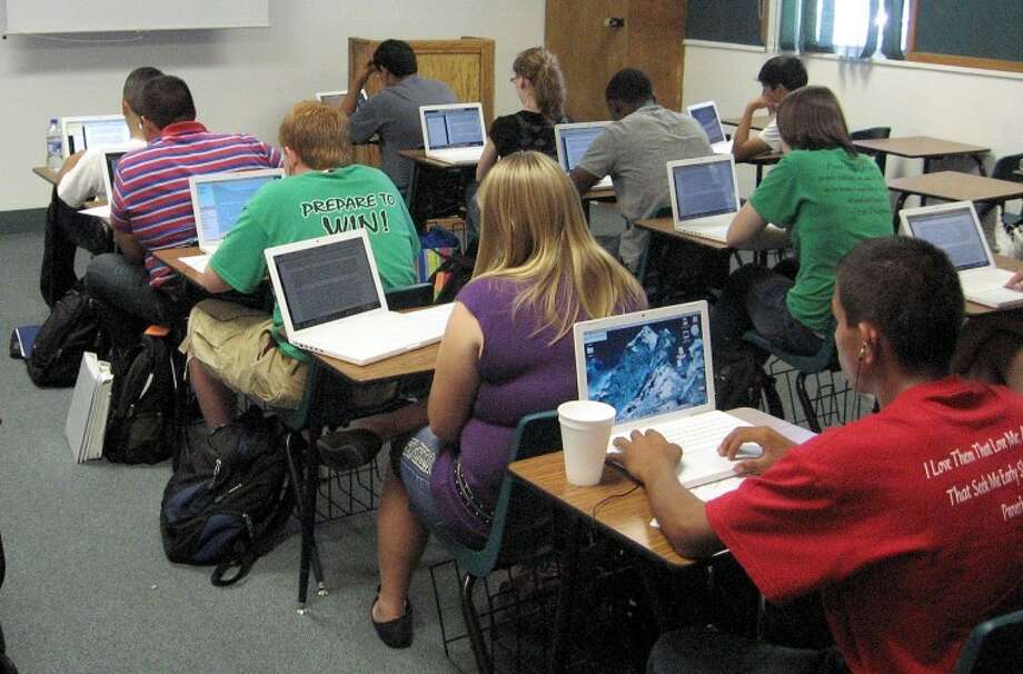 Students in Floydada use laptops in the classroom as part of the district's one-to-one immersion in technology.