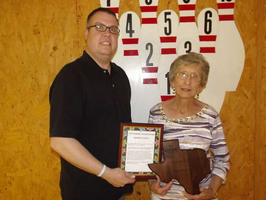 Waynelle Couch (right) accepts the League Officer Award from Jeff Wertz at the Lubbock United States Bowling Conference Association banquet Saturday night. Waynelle is the secretary of the Monday Night Gutter Dusters Women's League in Plainview. Photo: Rosemary Gonzales/Plainview Herald