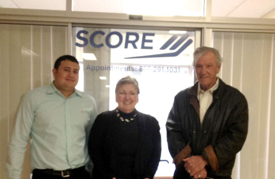 Courtesy PhotoEric Spencer (left) with Small Business Administration, Janice Payne with Plainview's SCORE chapter and Don Schenkel, Lubbock SCORE chapter chair, visit at the local SCORE office inside Wayland's Nunn Business Building.