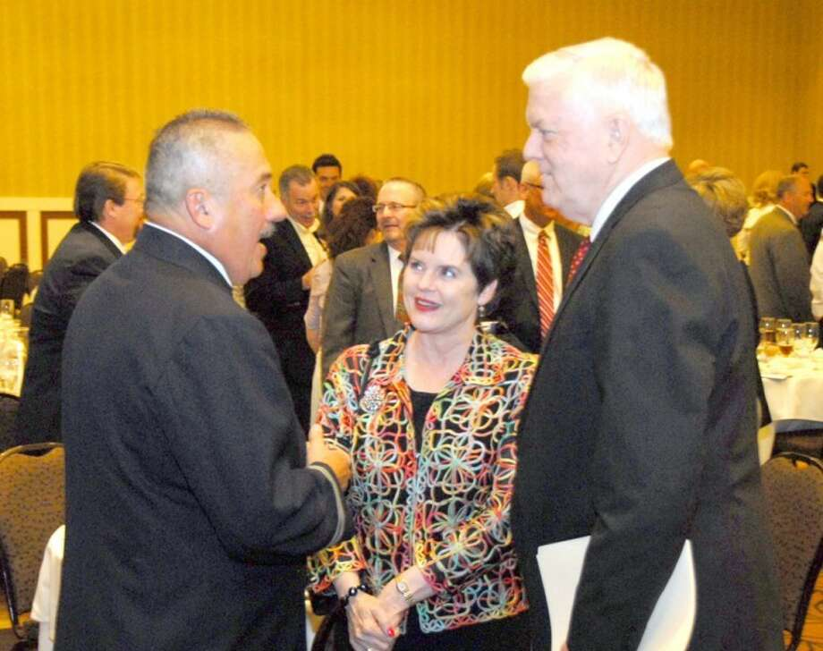 Wayland Baptist University PhotoAl Fuentes, retired captain from the New York City Fire Department, speaks to Wayland President and first lady, Dr. Paul and Duanea Armes, at the Lubbock Lights Gala on Tuesday. Fuentes was the featured speaker at the event to raise scholarship funds for students at Wayland Baptist University's Lubbock campus who are first responders.