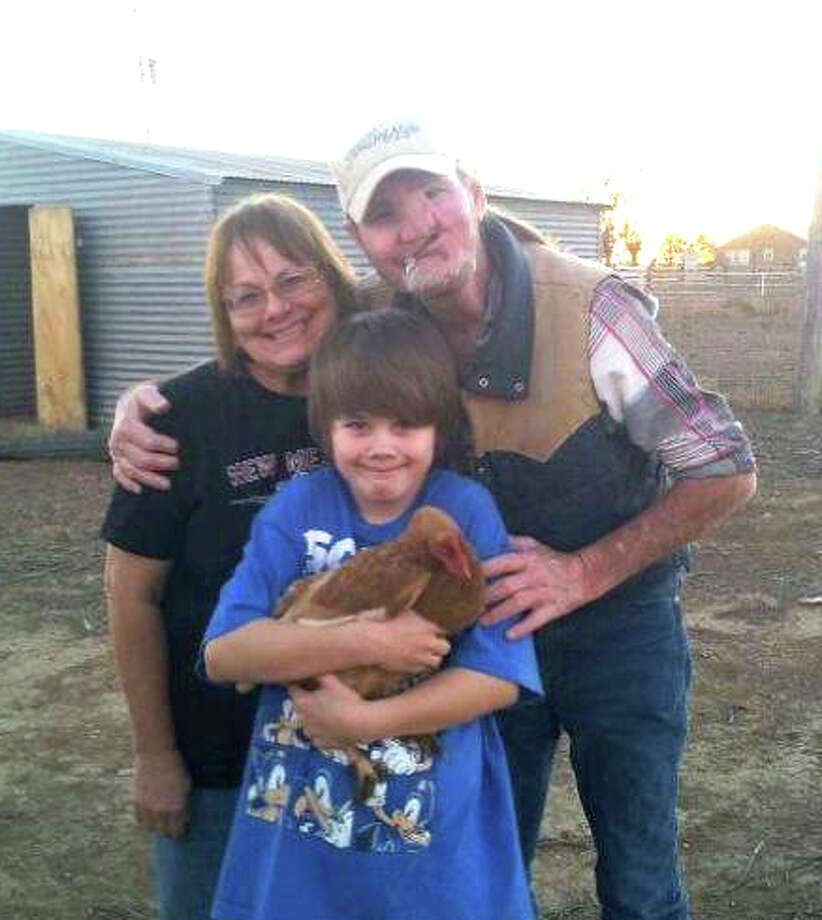 The late Terry Lynn Borum poses with grandson Blake Russell and sister Debbie Borum Monroe at the family farm near Kress Photo: Courtesy Photo