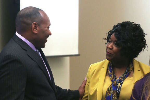 City Public Service board member Derrick Howard (left) speaks Monday July 25, 2016 with Paula Gold-Williams (right) during board meeting. Gold-Williams has been interim CEO of CPS since Doyle Beneby left.