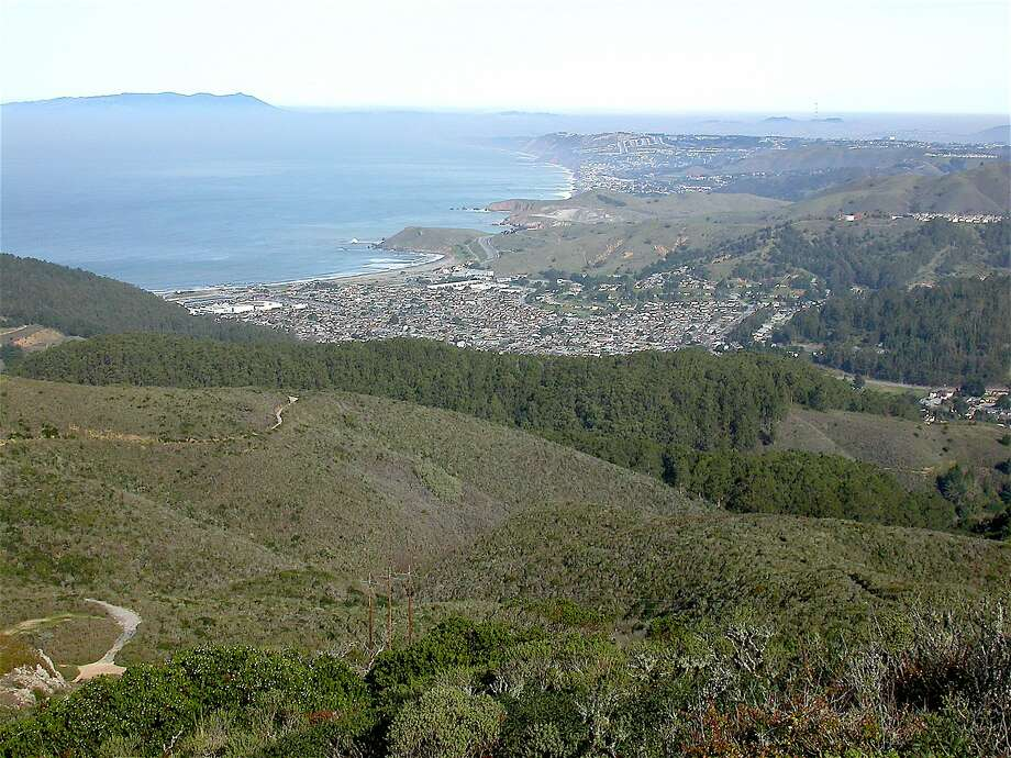 This view across Pacifica and north along San Francisco coast is from rock outcrop on flank of San Pedro Ridge near trail to top of Montara Mountain, which rises up 1,898 feet between Half Moon Bay to the south and Pacifica to the north. Its summit provides spectacular views of the coast and an amazing swatch of contiguous wildlands. The best hike to the summit is from San Pedro County Valley Park in Pacifica. Photo: Tom Stienstra, Tom Stienstra / The Chronicle