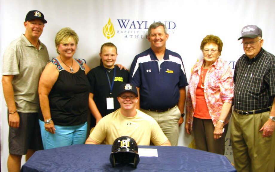 Garrett West (seated) was one of six freshmen to sign on with the WBU baseball team Friday afternoon. Garrett is surrounded by (from left) dad Landon, mother Tracey, sister Natalie, WBU head baseball coach Brad Bass, and grandmother and grandfather Norma and Jim West of Plainview. Photo: Calvin Bass/Wayland Baptist University