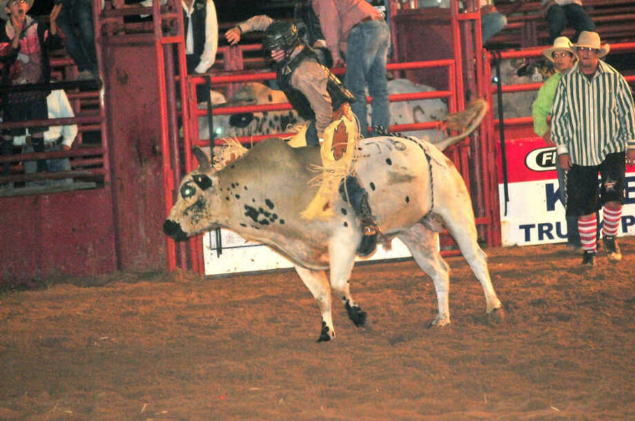 Pistol Preece of Brock gets the 8-second bullride during the open night of the Bar-None Rodeo Friday in the Plainview arena. With the ride, Preece scored 83 points, putting him in the first place position. Rodeo action from the 69th annual concluded Saturday night. Photo: Homer Marquez/Plainview Herald