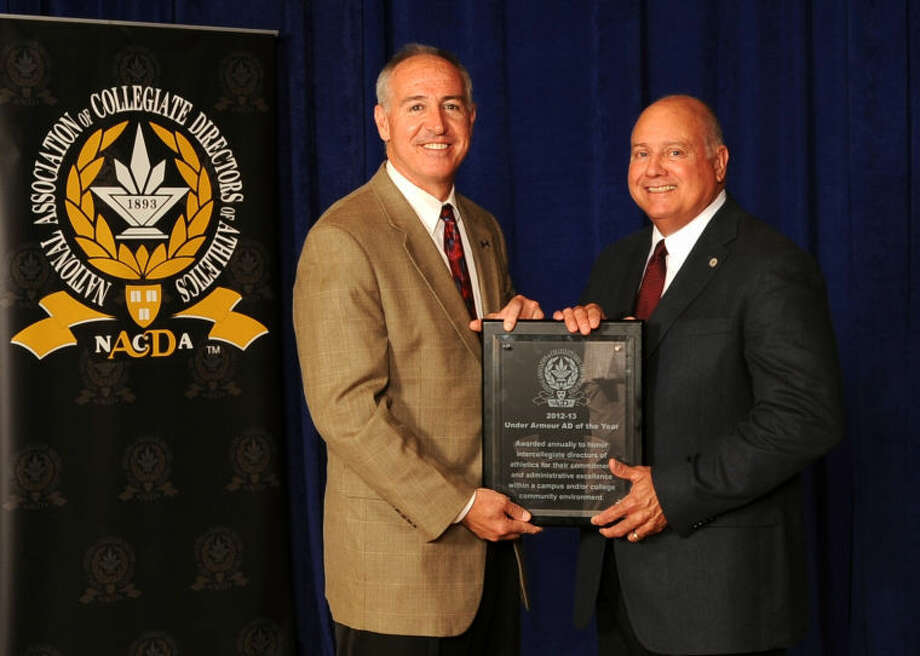 Wayland Baptist's Dr. Greg Feris (right) receives the Under Armour Athletics Director of the Year award from Sean Sullivan of Under Armor. Photo:  Photo Courtesy Of Joan Tiefel